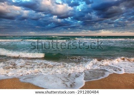 tropical sea shore on a cloudy day - stock photo