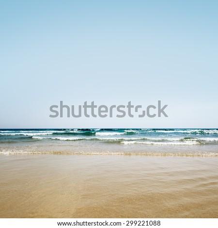tropical sea under the blue sky beach background wave of the sea on the sand beach - stock photo