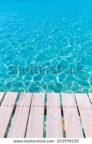 Tropical sea water texture from a wooden pier like paradise summer vacation - stock photo