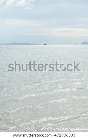 Tropical sea water with bright sun light reflections. Sea background