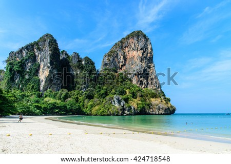 Tropical sea with limestone hill and blue sky background at railay beach krabi Thailand - stock photo