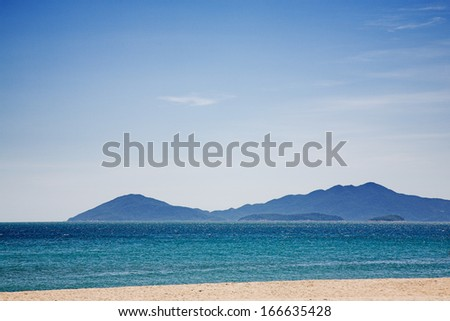tropical sea with mountain island