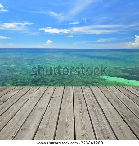 Tropical seascape and empty wooden platform - stock photo