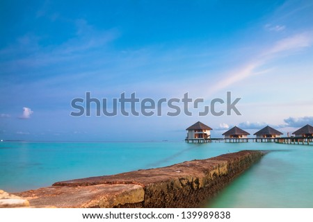tropical seascape. over-water bungalow, Maldives island - stock photo