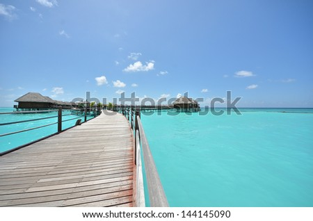 Tropical seascape -- overwater villas on the tropical lagoon   - stock photo