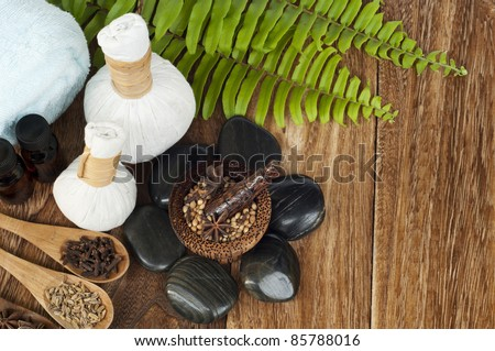 tropical spa setting on wooden board - stock photo
