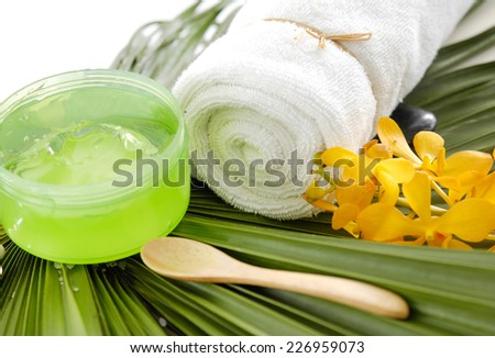 Tropical spa sitting with orchid ,towel on green palm