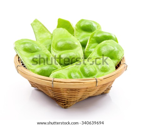 Tropical stinking edible beans in basket on white background. (Parkia Speciosa)