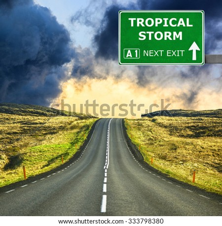 TROPICAL STORM road sign against clear blue sky - stock photo