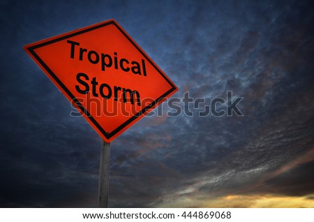 Tropical Storm warning road sign with storm background - stock photo