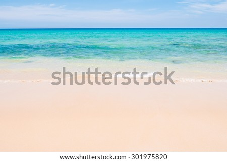 Tropical summer beach and sea wave on blue sky background