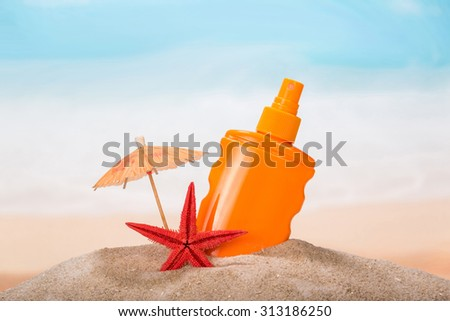 Tropical summer items with lotion - stock photo