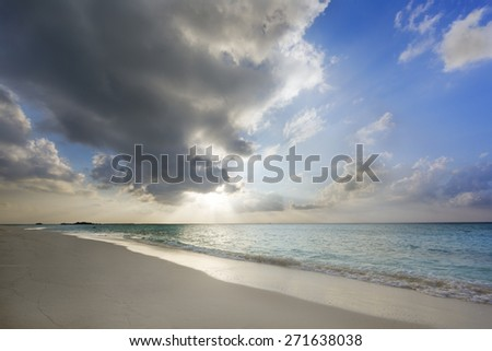Tropical sunset near the island beach at Maldives - stock photo