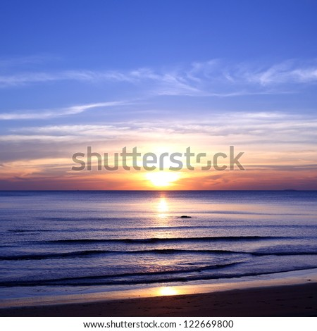 Tropical sunset on the beach of sea of thailand
