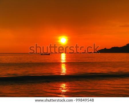 Tropical sunset on the Palolem beach, Goa, India - stock photo