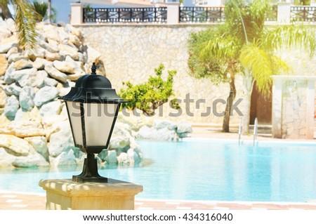 Tropical swimming pool. Spain. Alicante - stock photo