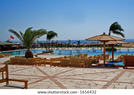 Tropical swimming pool with sea background