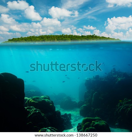 Tropical underwater shot splitted with island and sky - stock photo