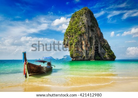Tropical vacation holiday tourism beach concept - Long tail boat on tropical beach, Krabi, Thailand