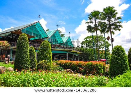 tropical villa with beautiful garden - stock photo