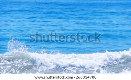 Tropical water (ocean, sea) background in sunny day - stock photo
