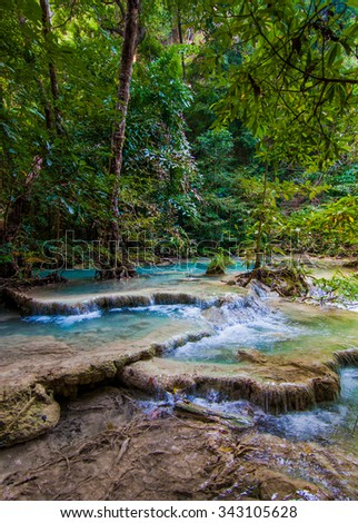 Tropical waterfall.  Deep forest Waterfall.  waterfall in the forest - stock photo