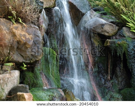 Tropical Waterfall over rocks