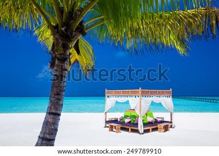 tropical wedding ceremony location. beautiful blue sky and palm tree - stock photo