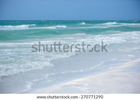 Tropical white sand beach and blue sky, Siesta Key beach, Florida - stock photo