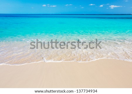 Tropical White Sand Beach and Sea In the Turks and Caicos Islands - stock photo