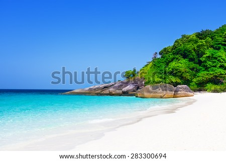 Tropical white sand beach arainst blue sky. Similan islands, Thailand, Phuket. - stock photo