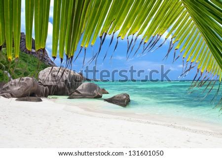 tropical white sand beach on la digue island - seychelles, The Beauty Of The Seychelles, huge Boulders at the Beach on the idyllic island of La Dique - stock photo