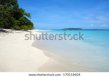 Tropical white sand beach with turquoise water and an island at the horizon, Caribbean sea, Zapatillas keys, Panama - stock photo