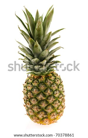 Tropical whole pineapple isolated over white background