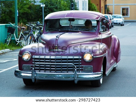 TROSA SWEDEN, 16 JULI 2015. An old Purple Dodge driving in the small town of Trosa in Sweden.