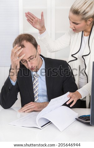 Trouble and harassment under business colleagues: bullying man and woman. - stock photo