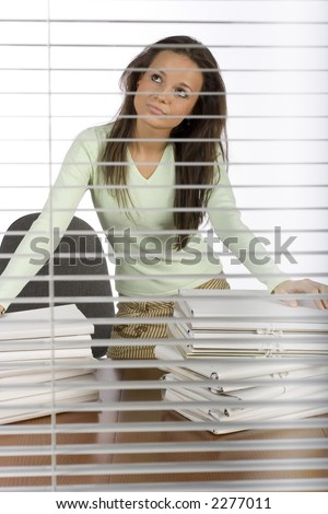 trouble woman in the office - view through the blind - stock photo