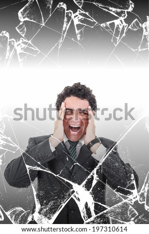 Troubled businessman with headache screaming in pain behind broken glass, Stressed man suffering from migraine with texture concept - stock photo