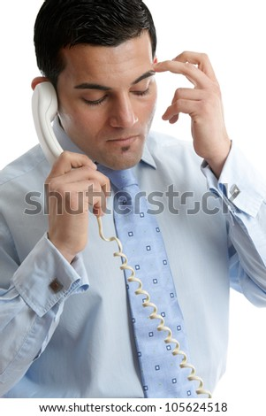 Troubled or depressed man making a phone call. - stock photo
