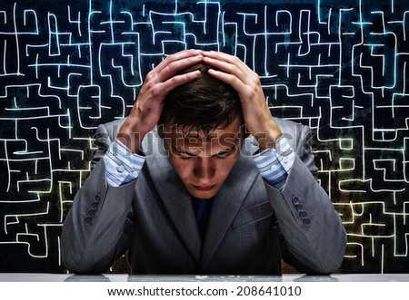 Troubled thoughtful businessman with hands on head - stock photo