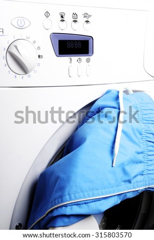 Trousers on the door of a laundry. - stock photo