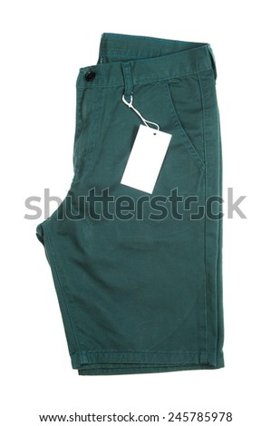 Trousers with tagging on white background - stock photo