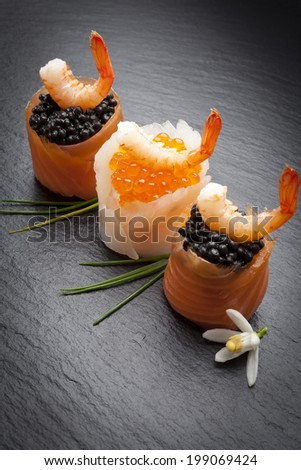 Trout Canapes with prawns and smoked salmon and caviar - stock photo