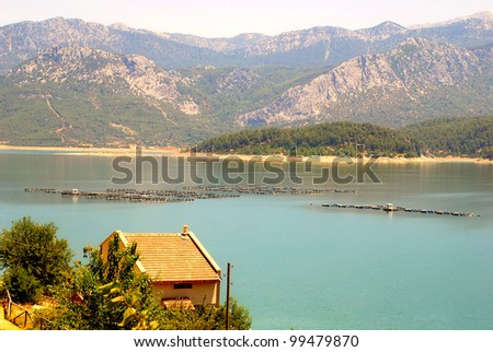 trout fish farm on the lake in mountains, Turkey - stock photo