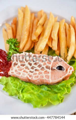 Trout fish with fried potato - stock photo