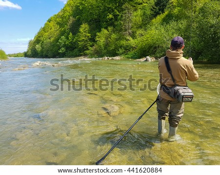 Trout fishing. Outdoors. Leisure - stock photo