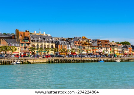TROUVILLE, FRANCE - JUN 7, 2015:  Touques River and Trouville, Normandy, France. Trouville is a village of fishermen and a popular tourist attraction in Normandy