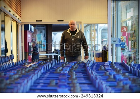 TROWBRIDGE - JAN 28: Shoppers exit a city centre Tesco store on Jan 28, 2015 in Trowbridge, UK. Tesco has announced the closure of 43 stores in the UK after reporting huge financial losses.  - stock photo