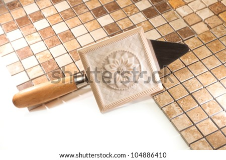 Trowel and marble mosaic tiles - stock photo