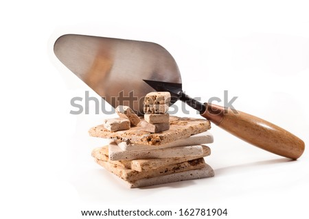 Trowel and tiles on white background - stock photo